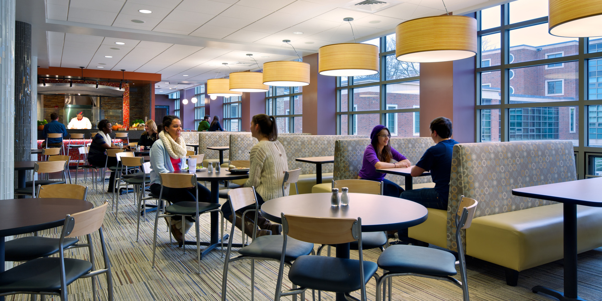 Here are students eating in a campus dining hall.
